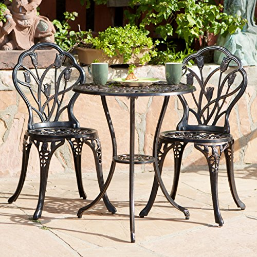 3-piece Bistro Set Tulip Design with 2 Chairs and a Table. Aluminum Brownish/copper. Indoor or Outdoor Patio Furniture. Cross Scented Tart Included For Sale