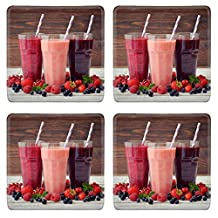MSD Natural Rubber Square Coasters IMAGE ID: 30096019 Three glasses of smoothies with different berries on wooden background