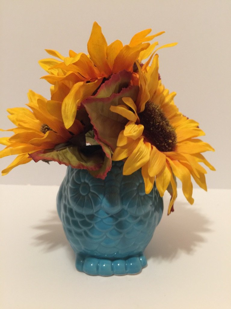 ANIMAL FUN - BLUE OWL VASE - YELLOW/ORANGE AND BROWN SUN FLOWERS
