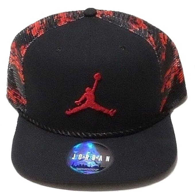 b1d841be2109df Nike Jordan Men s Jumpman Camo Trucker Snapback Hat Red Black  Amazon.ca   Clothing   Accessories