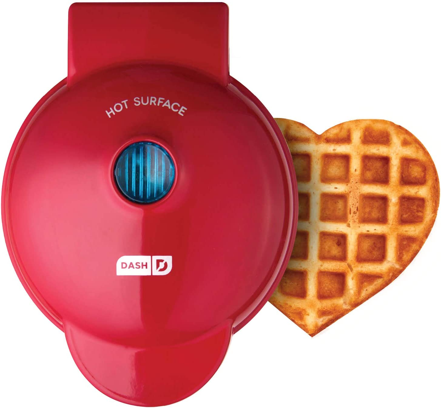 A red-colored waffle maker with a cooked heart-shaped waffle on the side.