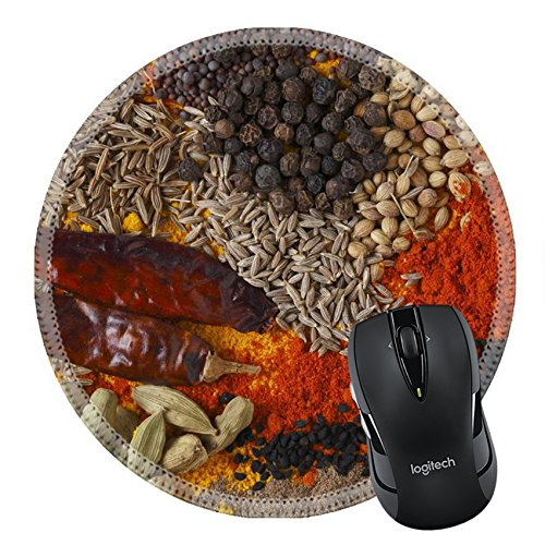MSD Mousepad Asian curry spices in the centre black pepper coriander seeds mustard cumin around that dried chillies Kashmiri chilli powder caraway saffron strands white mistared Round outside ()