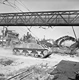 Home Comforts The British Army in Italy 1944 A Sherman tank of 16th/5th Lancers passes through a railyard in Arezz.