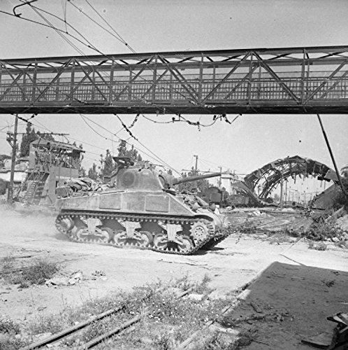 Home Comforts The British Army in Italy 1944 A Sherman tank of 16th/5th Lancers passes through a railyard in Arezz. by Home Comforts