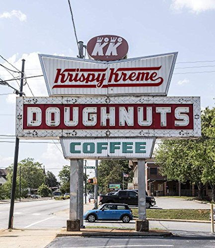 Photograph- Enormous sign for a donut shop in Spartanburg, South Carolina, a city in the foothills of the Blue Ridge Mountains roughly midway between Atlanta, Georgia, and Charlotte 44in x 55in