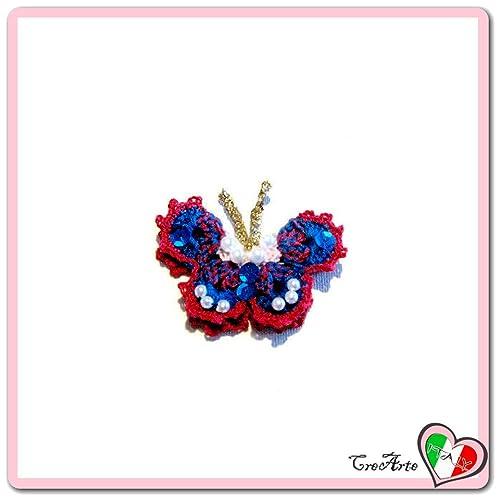 Mariposa azul y roja para aplicaciones, broche o imán de ...