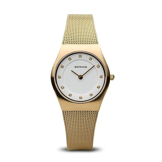 Bering Classic - Reloj analógico de mujer de cuarzo con correa de acero inoxidable dorada - sumergible a 50 metros