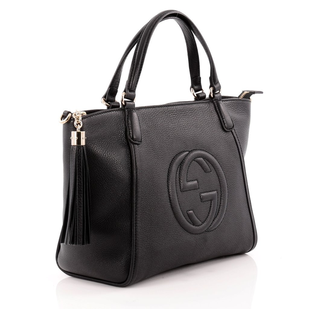 c7326d6a8149 The Soho shoulder bag is characterized by its embossed interlocking G and  tassel detail. Made in one of our signature smooth leathers, noted for its  ...