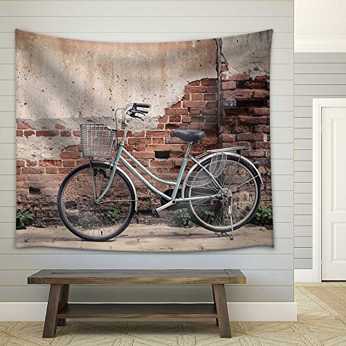Vintage Bicycle with Old Brick Wall and Copy Space Fabric Wall