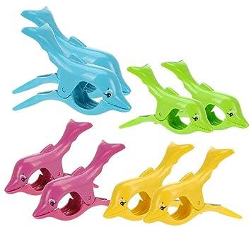 Pinzas de plástico para sujetar la toalla a la tumbona, diseño de delfín: Amazon.es: Jardín