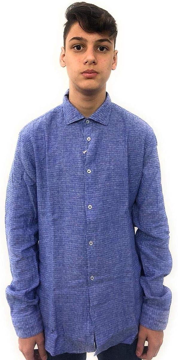 MANUEL RITZ Camisa color celeste en micro fantasía. Cierre de ...