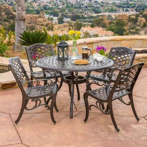 'Covington Antique Bronze Outdoor Patio Furniture 5pcs Cast Aluminum Dining Set' from the web at 'https://images-na.ssl-images-amazon.com/images/I/61CiEMjkQLL.jpg'