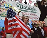 #6: Joey Chestnut Autographed 8'' x 10'' American Flag Photograph with GOAT Inscription - Fanatics Authentic Certified