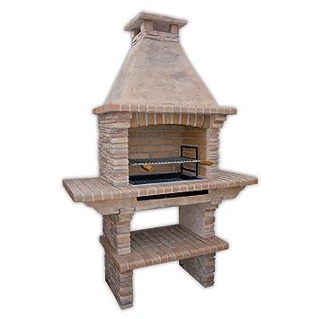 Barbacoa de piedra de mampostería con parrilla y tablas laterales