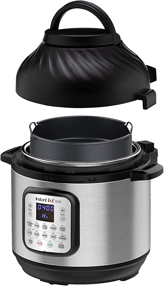 stainless steel instant pot with an air fryer attachment. fully roasted chicken next to it