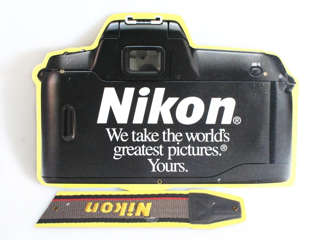 Nike - Cartel con cámara y correa: Amazon.es: Oficina y papelería