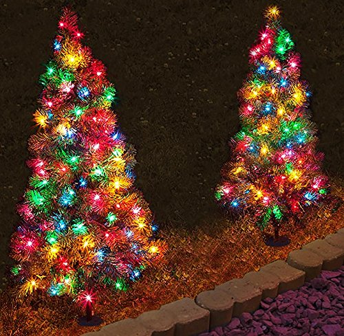 Set of 4, Pre-Lit 2' Tall Artificial Pathway Christmas Trees for Indoor/Outdoor use. Includes 50 multi color led lights, steel ground stake and three point deck stand by Kringle Bros