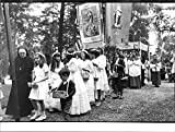 Vintage photo of Traditional Catholic procession in the beautiful park at the St. Bridget chapel.
