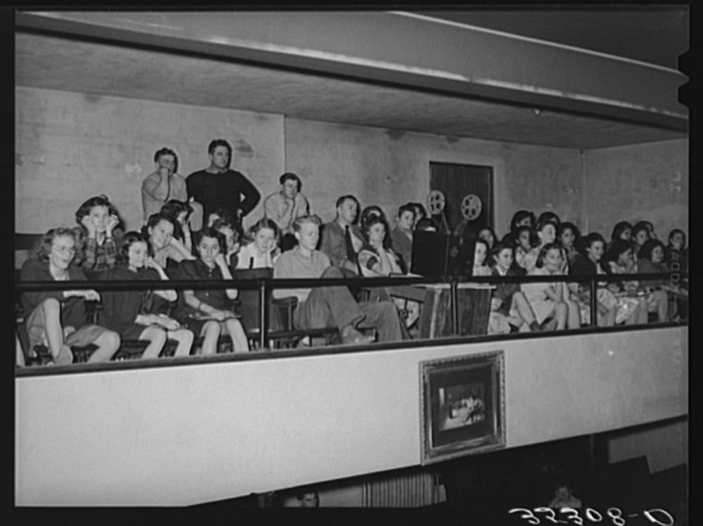1940 Photo High school students in balcony of school auditorium watching moving picture which was part of the Americanization program. Eufaula, Oklahoma Location: Eufaula, Mcintosh County, Oklahoma