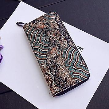 Burenqi@ La Dama de la cartera en el bolso de mano con una ...