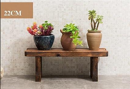 Racchetta di finitura vaso da fiori. balcone passo sagomato sgabello