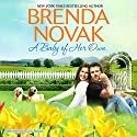 A Baby of Her Own: Dundee, Idaho, Book 1 Audiobook by Brenda Novak Narrated by Carly Robins