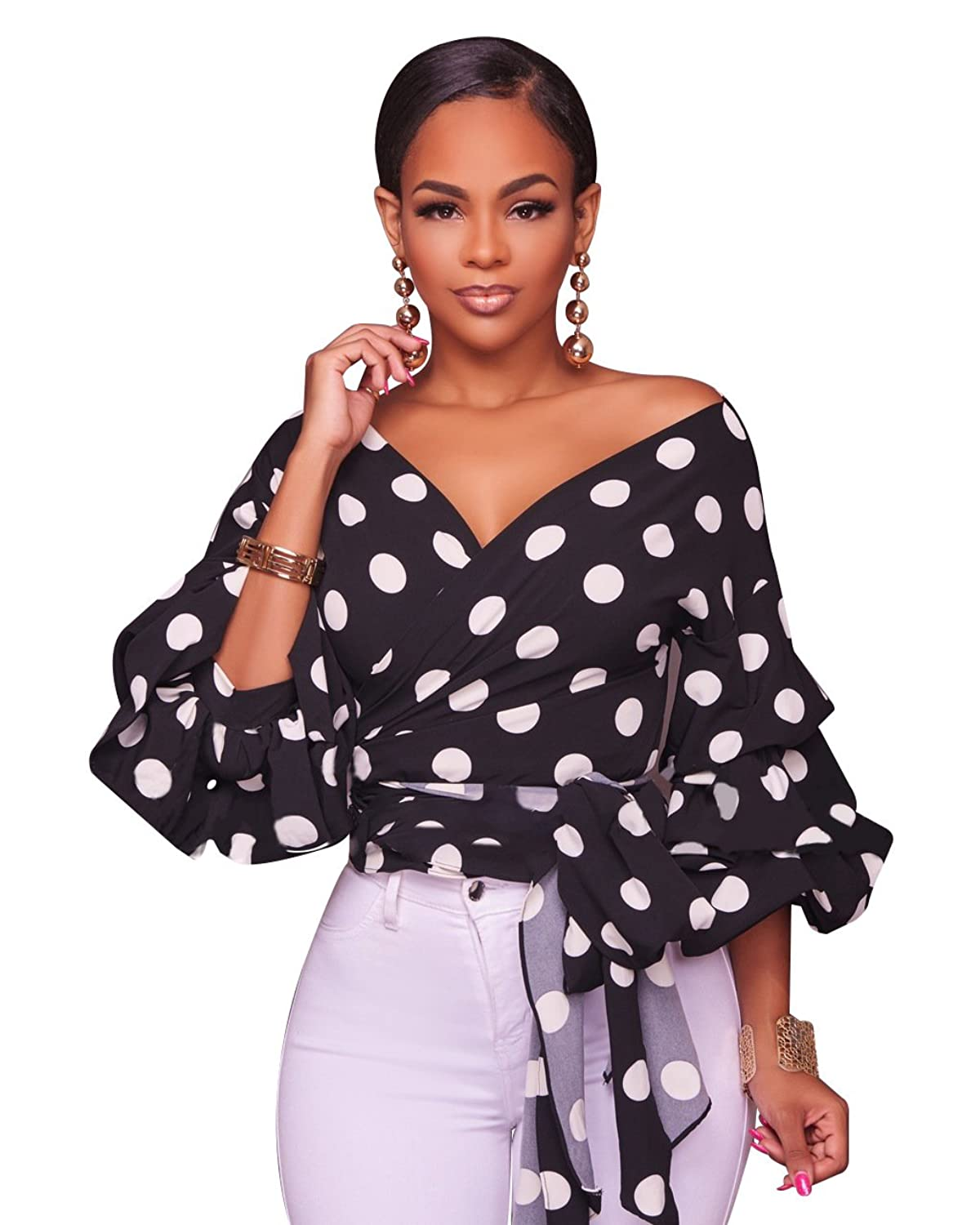 60f10239822 A knit wrap blouse top featuring an allover polka dots design, a surplice  neckline, 3/4 sleeves, self-tie front detail, a chic blouson silhouette, ...
