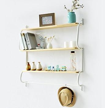 Rustikale sich hin- und herbewegende Buch-Regale an der Wand ...