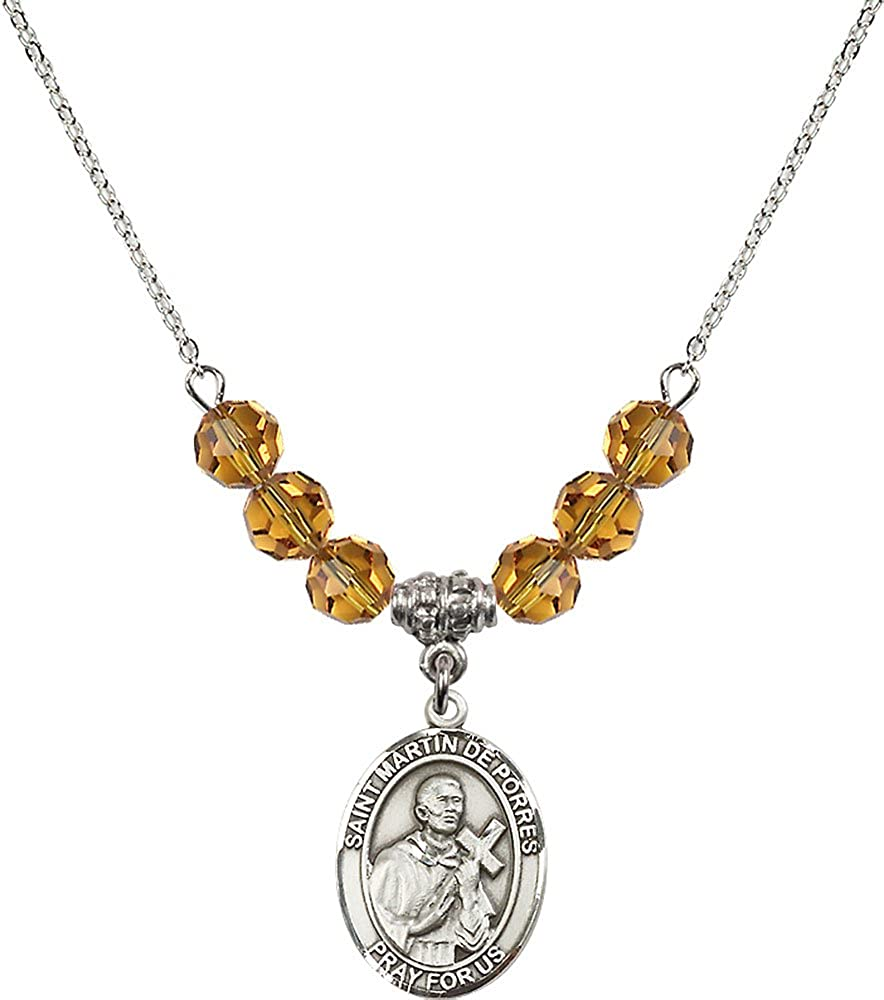 18-Inch Rhodium Plated Necklace with 6mm Topaz Birthstone Beads and Sterling Silver Saint Martin de Porres Charm.