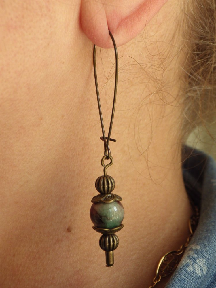Thurcolas earrings in vintage style in jade tinged with green and brown mounted on fantasy hoops in antique bronze