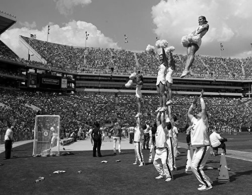 24 x 36 B&W Giclee Print The Cheerleaders are Amazing to Watch. The Boys Throw The Girls into The air as They Cheer on Their Winning Team. University Alabama Football Game, Tu 2010 Highsmith 56a ()