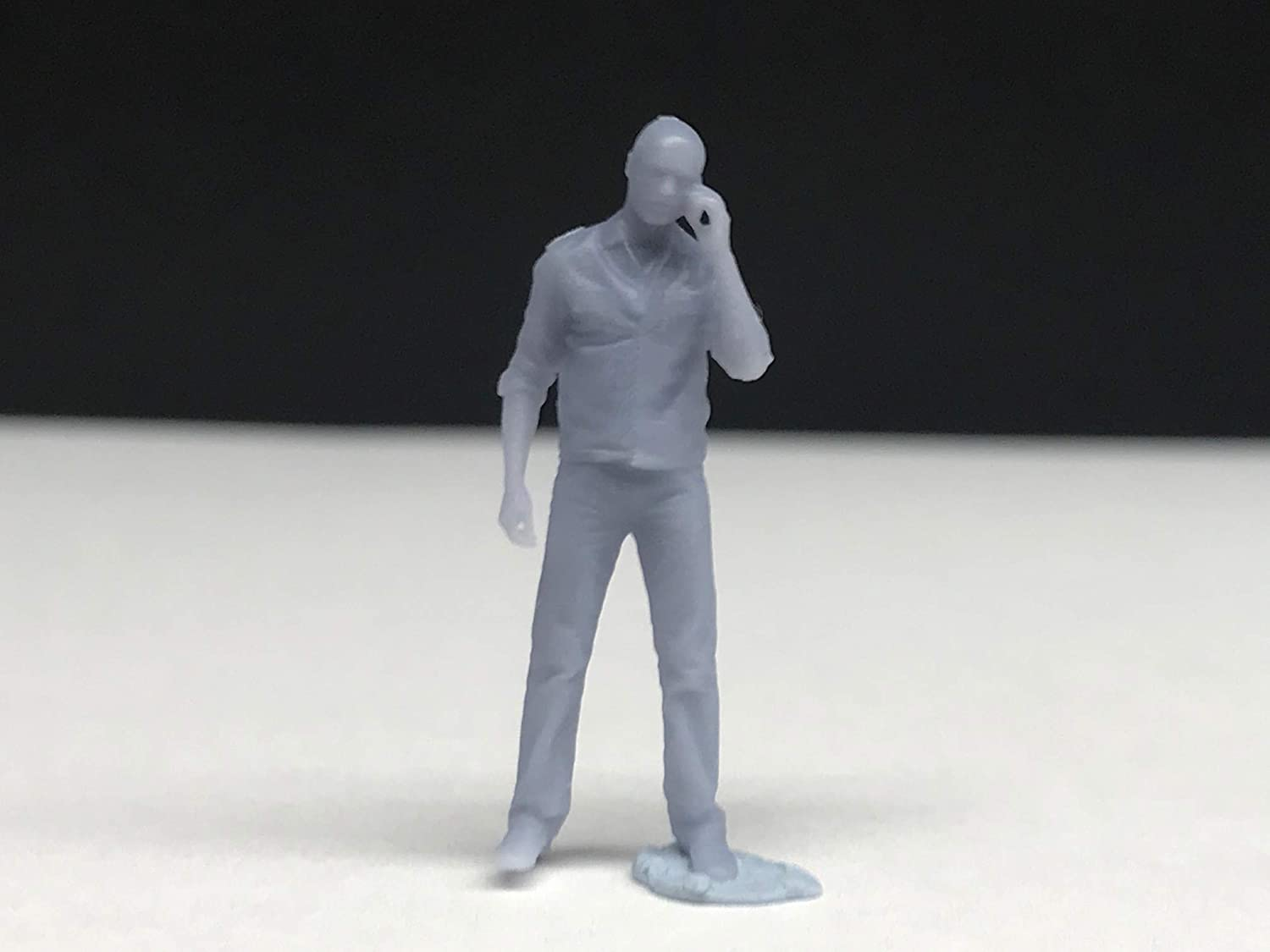 1:64 Miniature Man on Cell Phone 1