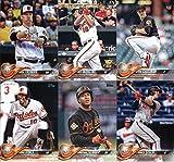 2018 Topps Baltimore Orioles Team Set of 11 Baseball Cards (Series 1): Dylan Bundy(#3), Chris Tillman(#5), Manny Machado(#25), Austin Hays(#62), Jonathan Schoop(#131), Adam Jones(#142), Chance Sisco(#185), Trey Mancini(#285), Mark Trumbo(#287), Baltimore Orioles(#292), Kevin Gausman(#343)