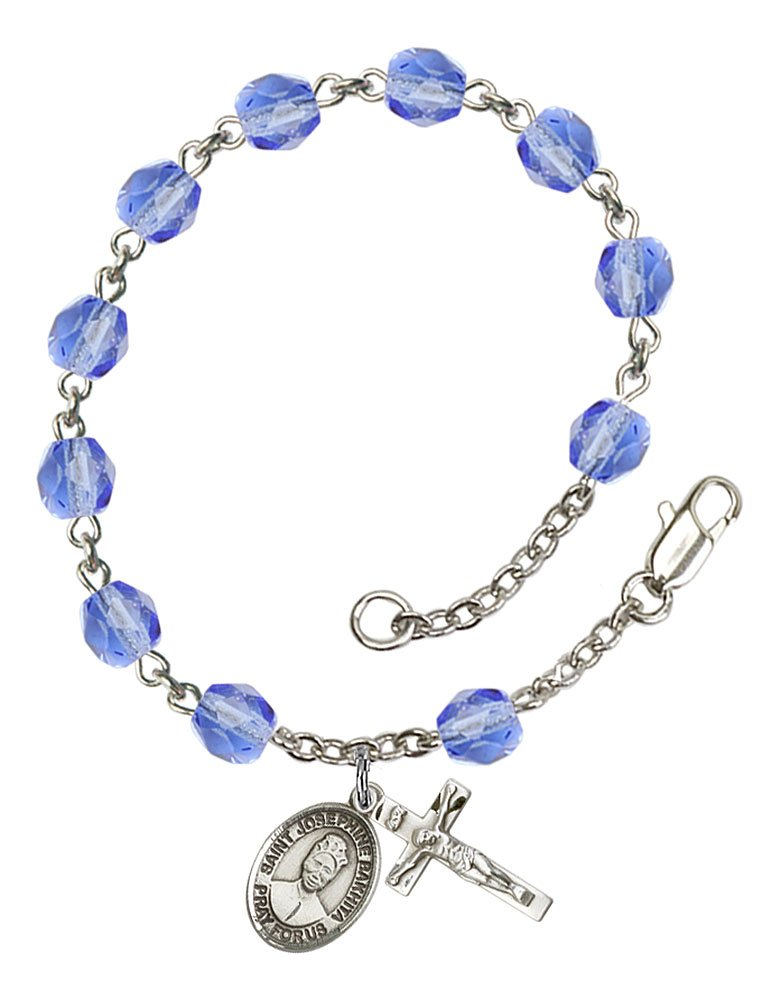 Silver Plate Rosary Bracelet features 6mm Sapphire Fire Polished beads. The Crucifix measures 5/8 x 1/4. The charm features a St. Josephine Bakhita medal.