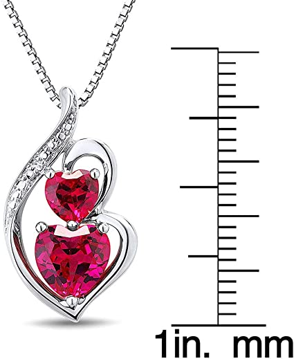 Sm womens or girl set in a silver heart and has a 16 silver chain with a 2  ext A 5mm round Ruby weighing.55 ct. Ruby Heart Pendant lab
