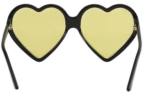 e2e3f03f697 Amazon.com  Gucci GG0360S 002 Heart Black Plastic Round Sunglasses Yellow  Lens  Clothing