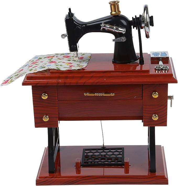 SODIAL(R) Caja de musica mecanica de estilo de mini maquina de coser vintage rebobinado: Amazon.es: Juguetes y juegos