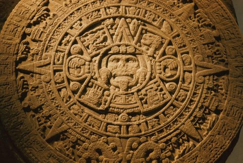 A Closeup of the Center of the 20-ton Aztec Sun Stone Which Depicts the Sun God and the Four Epochs of the Creation and Destruction of the Universe in Aztec M Ythology Other Symbols Represent the 20 Days of the Aztec Month Wall Decal Mural - 24 Inches W x 16 Inches H - Peel and Stick Removable Graphic