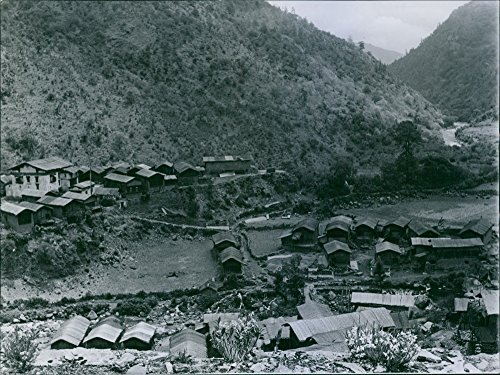 Vintage photo of The largest village in the monba country. All the houses are roofed with bamboo matting.The big whitewashed building on the left, which has a timber roof. - Whitewashed Buildings
