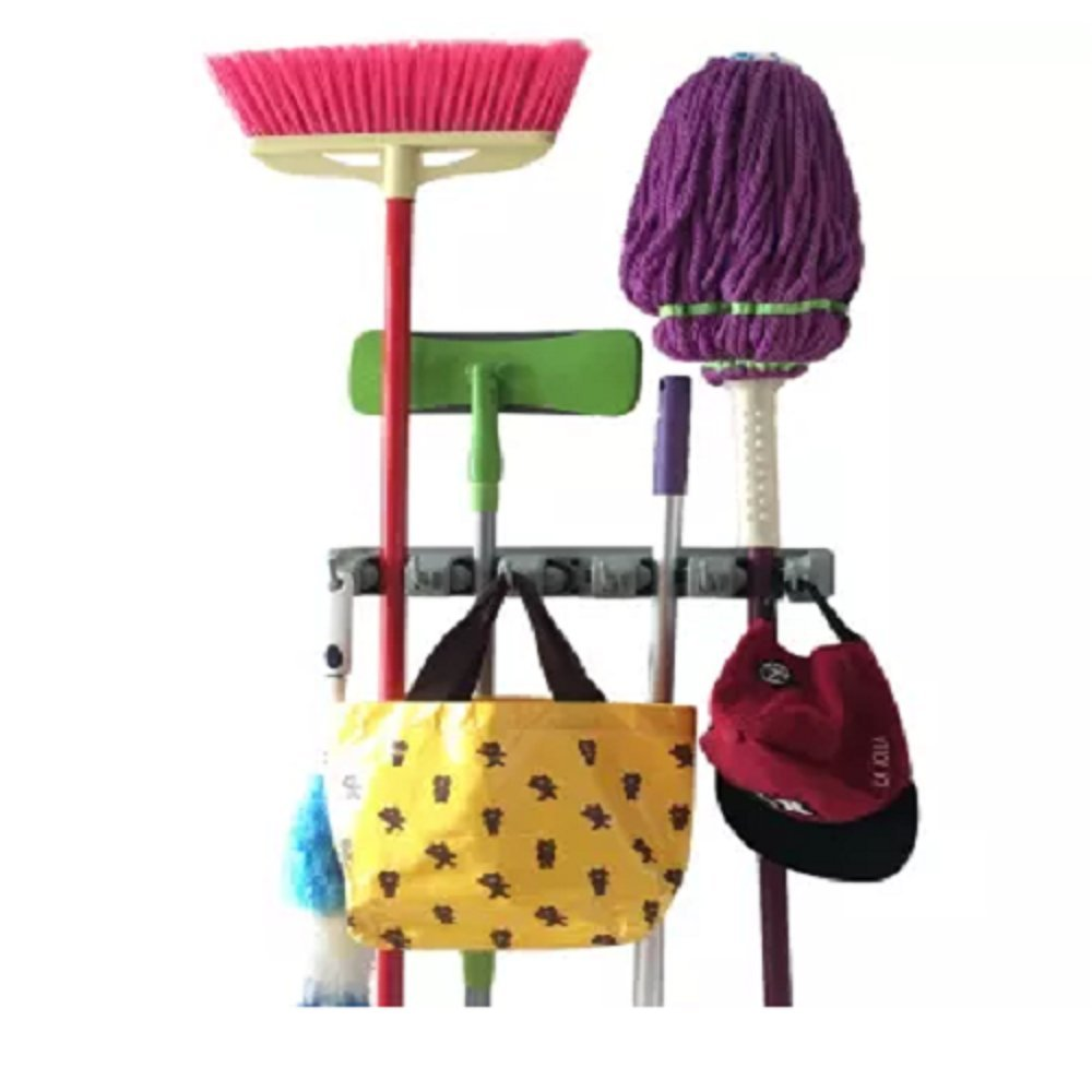 Champ Grip. Strongest Grippers Mop Broom Holders with 5 Ball Slots and 6 Hooks. Items Guaranteed Non Slide. Life-time Guarantee. CHAMP GRIP® 3935944