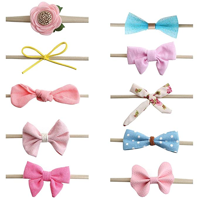 x3 baby head bands all 0-6 month pink purple and white with a flower//bow detail.