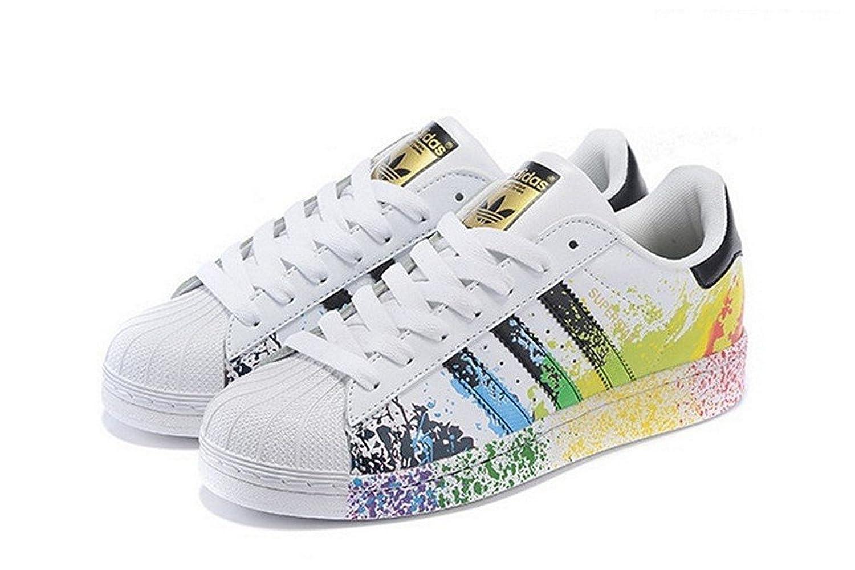 scarpe adidas superstar con schizzi di colore geometri