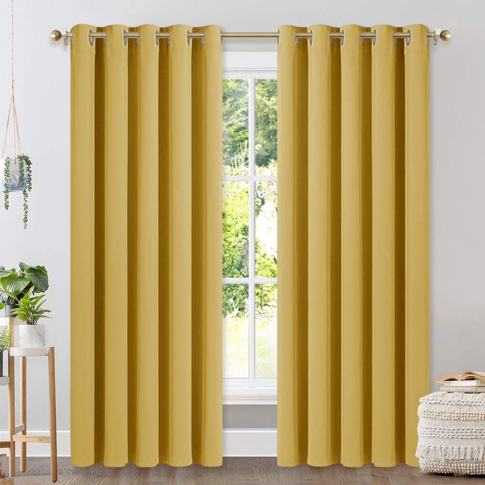 NICETOWN Bedroom Curtains Blackout Draperies, Home Decorations Thermal Insulated Solid Grommet Top Blackout Drapes for Cafe (Yellow, One Pair, 70 x 84-inch)