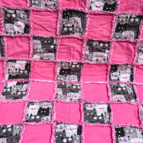 Pink and grey smiling cats surrounded by pink squares-with a reversible pink and white backing-baby rag quilt by Laughing Heart Designs