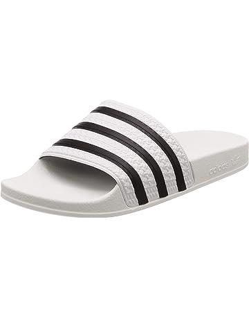 0c6d948afea adidas Originals Adilette, Zapatos de Playa y Piscina Unisex Adulto