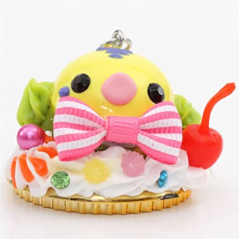 Figura de postre con cara de pájaro salsa amarilla verde fruta lazo cuenta Japón