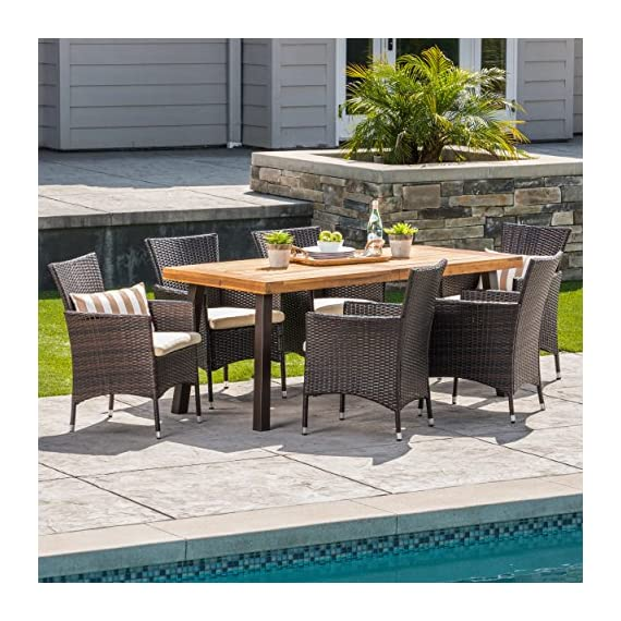 Christopher Knight Home Randy | Outdoor 7-Piece Acacia Wood and Wicker Dining Set with Cushions | Teak Finish | in Multibrown/Beige, Rustic Metal - The beautiful blend of wood and wicker comes to life with this dining Set, complete with six wicker dining chairs and one wooden table, you can enjoy eating in your backyard whenever you want, The wooden table is treated to withstand even the harshest of seasons, ensuring your Set looks great all year long, This set also comes with the added benefit of cushions for your seats, giving you the perfect color contrast Includes: one (1) table and six (6) chairs Table material: Acacia wood | table leg Material iron | chair Material: faux wicker | chair frame material: iron | Cushion material: Water resistant fabric | Composition: 100 percent polyester | table top finish: teak | table leg Finish: rustic metal | wicker finish:  | Cushion color: Beige - patio-furniture, dining-sets-patio-funiture, patio - 61G VxVEKqL. SS570  -