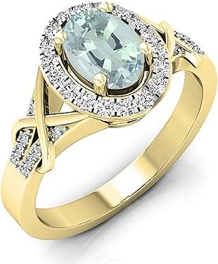 Sortija de oro con diamantes en corte redondo y aguamarina ovalada