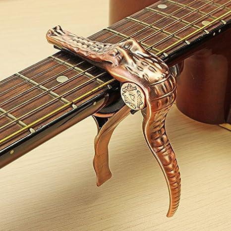 Guitarra acústica eléctrica banjo ukulele cambio rápido bronce cocodrilo gatillo capo: Amazon.es: Instrumentos musicales