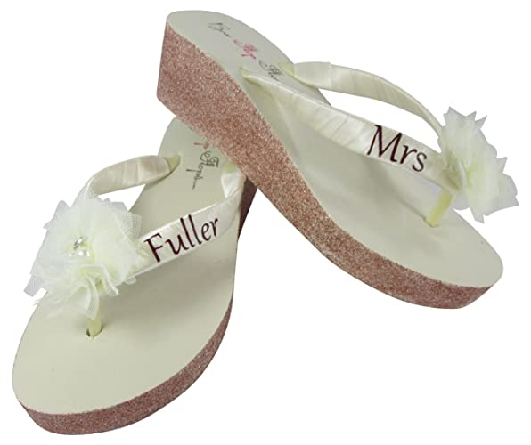 31c45d242fca0e Amazon.com  Customizable Ivory Mrs Glitter Wedge Flip Flops ...